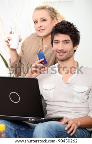 Couple doing online shopping. - stock photo
