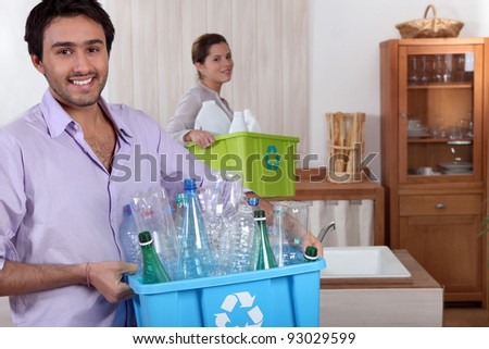 couple doing recycling - stock photo