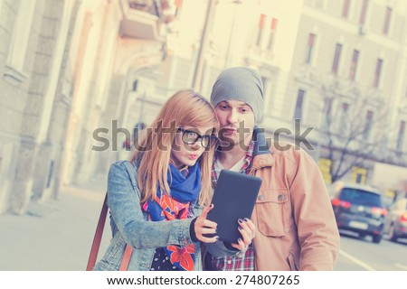 Couple doing selfie outdoors. - stock photo