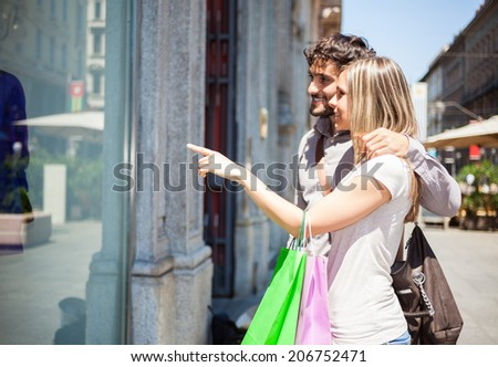 Couple doing shopping in a urban street - stock photo