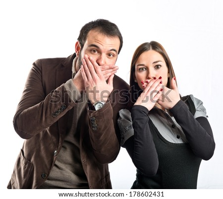 Couple doing surprise gesture over white background  - stock photo