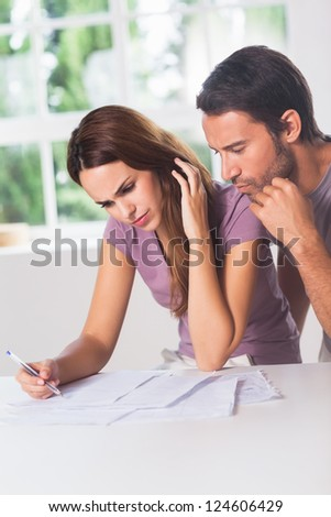 Couple doing their accounting in house - stock photo