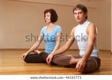 couple doing yoga practice indoors - stock photo
