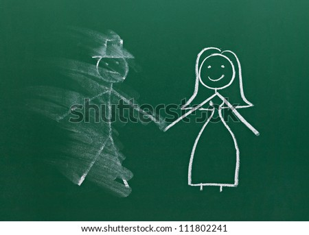 couple drawing on chalk board - stock photo