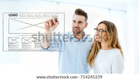 couple drawing website development wireframe