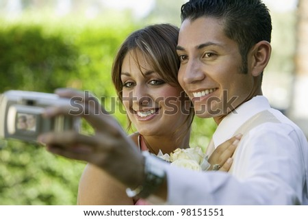 Couple Dressed for Dance Taking Self Portrait - stock photo