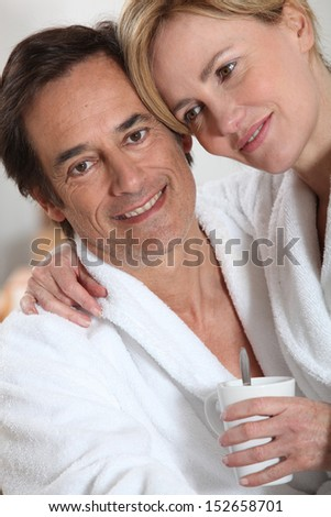 Couple dressed in bath robes