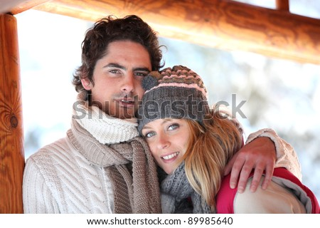 Couple dressed in winter clothing - stock photo