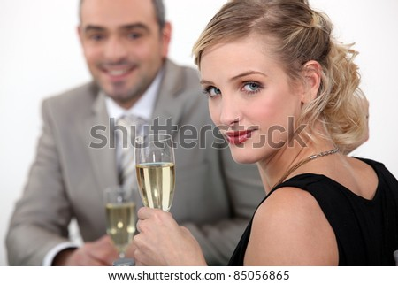 Couple drinking champagne. - stock photo