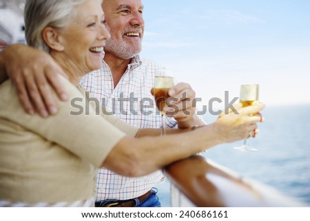 Couple Drinking Champagne on Cruise Ship - stock photo
