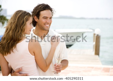 Couple drinking champagne on holiday
