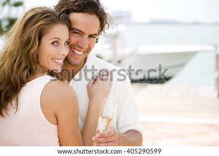 Couple drinking champagne on holiday - stock photo