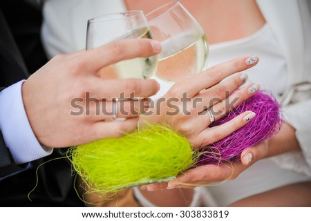 Couple drinking champagne wishes pronounced during the wedding ceremony, wedding decor. Blur macro effect. - stock photo