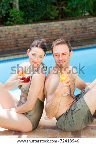 Couple drinking cocktails back to back