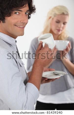 Couple drinking coffee - stock photo