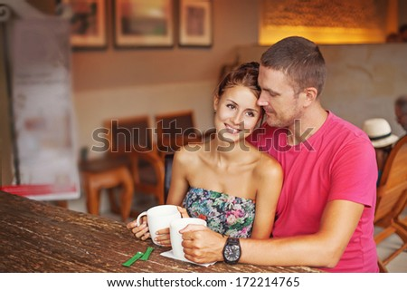 couple drinking coffee in cafe  - stock photo