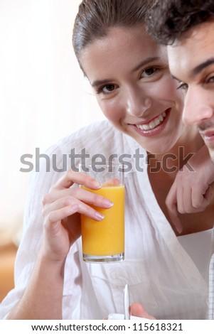 Couple drinking fruit juice - stock photo