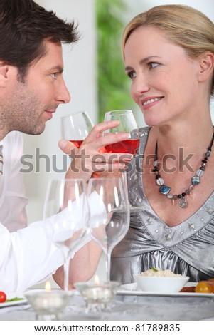 Couple drinking rose wine - stock photo