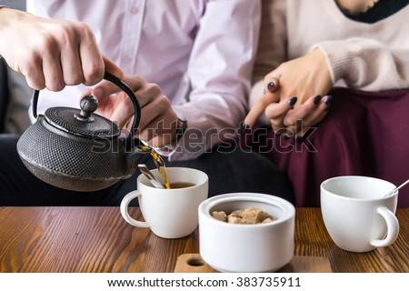 couple drinking tea in the cafe - stock photo