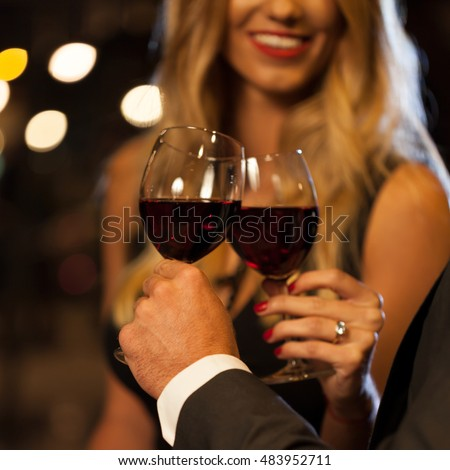 Couple drinking wine after proposal in the city