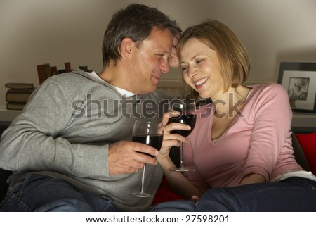 Couple Drinking Wine And Not Watching Television - stock photo
