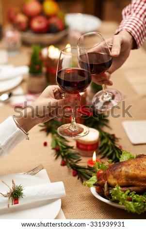 Couple drinking wine at Christmas celebration - stock photo