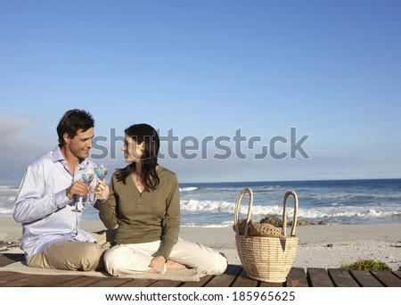Couple drinking wine on beach, Cape Town, South Africa