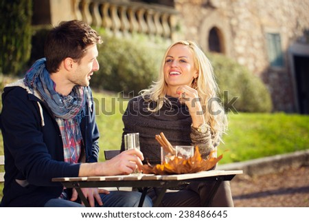 couple drinks an aperitif - stock photo
