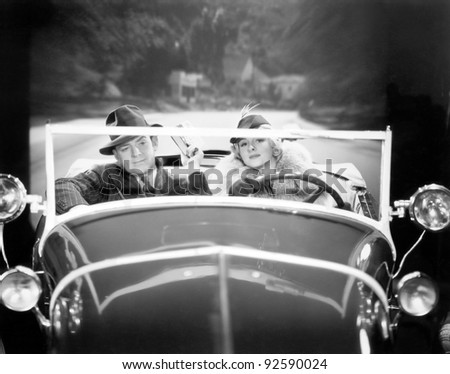 Couple driving a car - stock photo