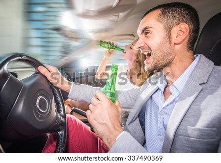 Couple driving drunk with the car. concept about bad behaviors on the street while driving - stock photo