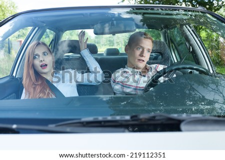 Couple during dangerous situation in a car