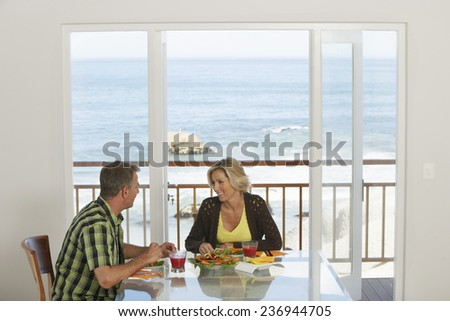 Couple Eating Lunch at Beach House - stock photo