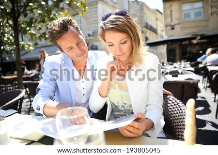 Couple eating lunch at restaurant - stock photo