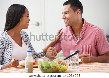 Couple Eating Meal Together At Home - stock photo