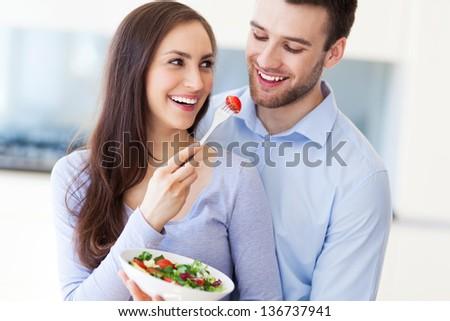 Couple eating salad - stock photo