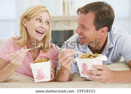 Couple Eating Takeaway meal,mealtime Together - stock photo