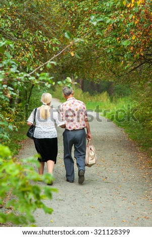 couple elderly people is on track in the green park