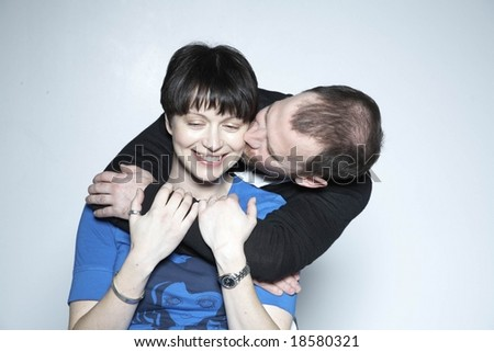 couple embrace and kiss - stock photo