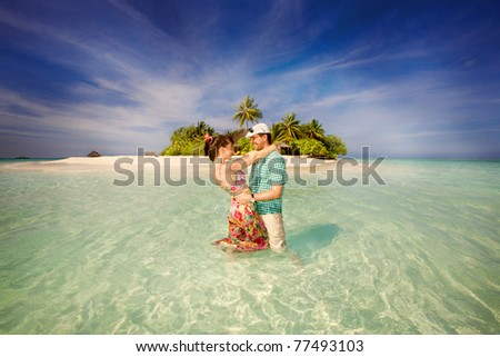couple embracing against of Ocean