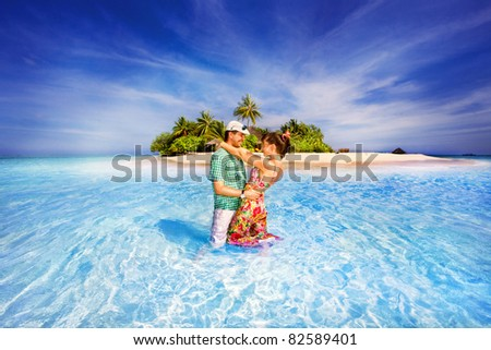 couple embracing against of Ocean - stock photo