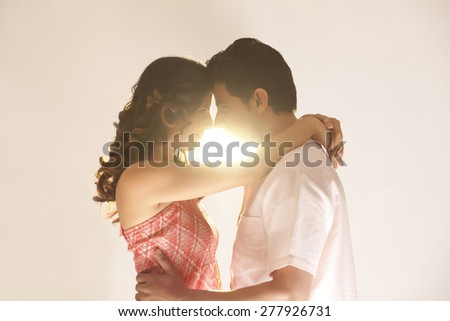 Couple embracing each other - stock photo