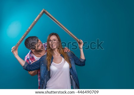 couple embracing holding concept roof - stock photo