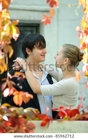 couple embracing in autumn park