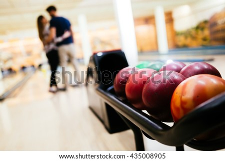 Couple enjoy bowling together  and hugging - stock photo
