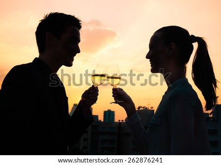 Couple enjoying a glass of wine in the city - stock photo
