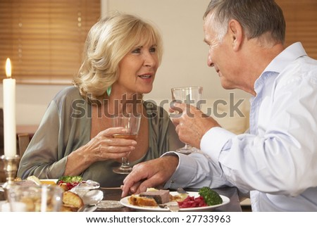 Couple Enjoying A Meal At Home Together
