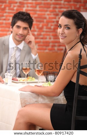 Couple enjoying a romantic meal together - stock photo