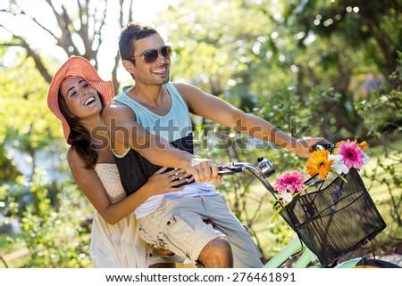 Couple enjoying a spring day biking in nature - stock photo