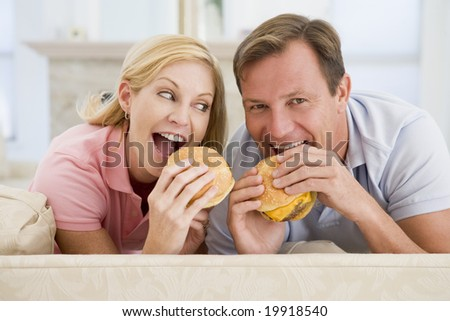 Couple Enjoying Burgers Together - stock photo