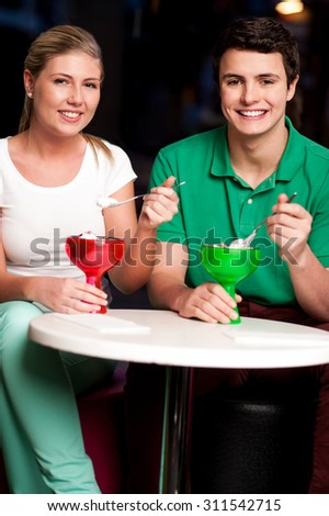 Couple enjoying day out in a restaurant - stock photo